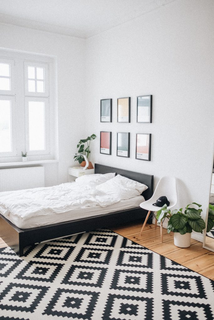 Pieces of art hung in a minimal rental living room
