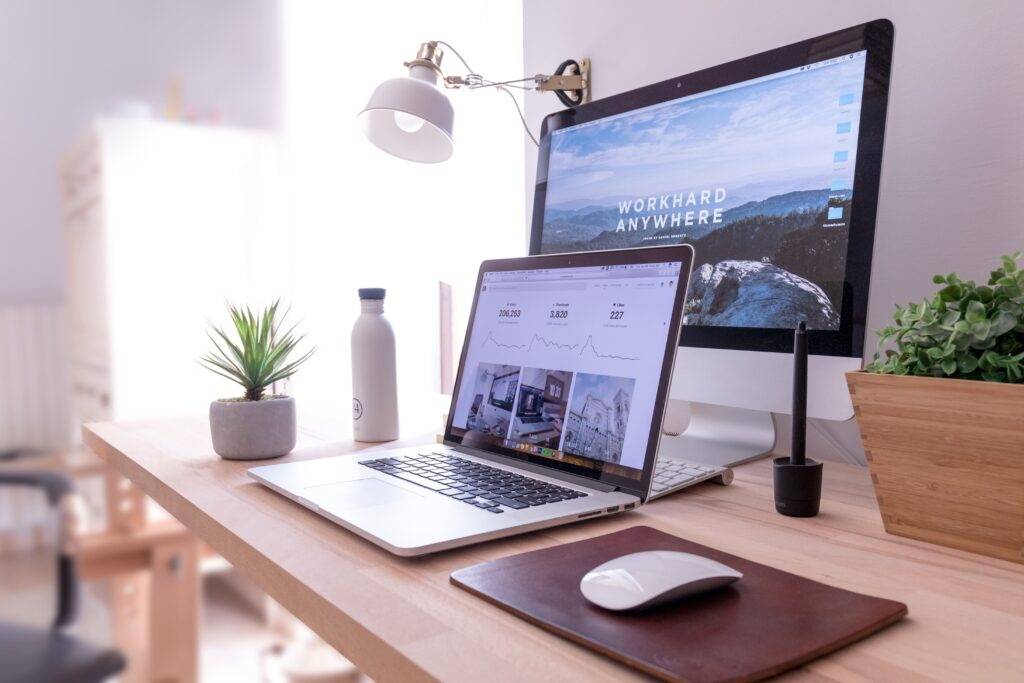 Clean, clutter-free desktop and macbook working from home set up